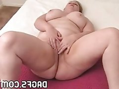 Thick mommy with gigantic tits masturbates in bed.