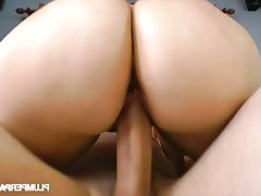 Voluptuous redhead belle blows a hard rod of meat