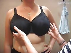 Busty brunette trying on bras no nude