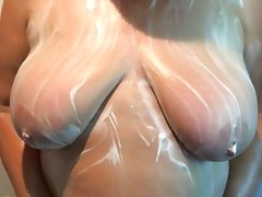 My wife soaping her big tits