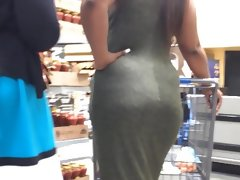 Candid ebony curves in olive dress (edited)
