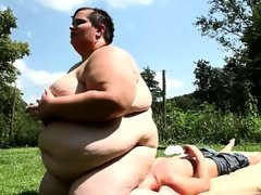 The fattest woman on earth sits on boys face